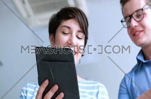 low angle shot of business people using technology