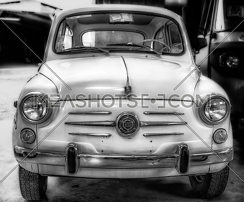 a black and white image of a vintage Fiat 600