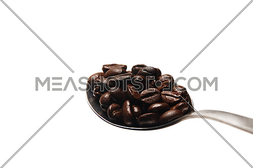coffee beans on a spoon close-up on white background