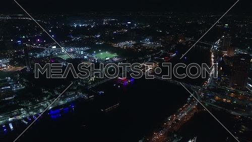 Fly over Cairo City showing the River Nile, Cairo Tower and Opera house at night - December 2018.