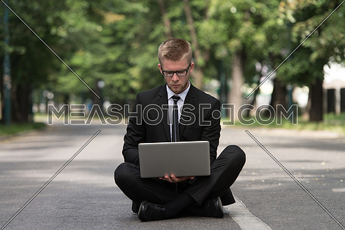Happy Business Man Using Tablet Pc Outside On Asphalt