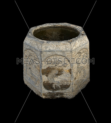 ancient stone bucket finely carved with iced water over black backgroungd