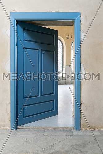 Blue wooden vintage door with yellow plaster wall, Cairo, Egypt