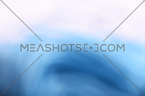 Abstract light blue and white cloudy wave and spiral blur background