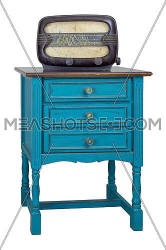 Vintage Furniture - Turquoise commode (Chest of Drawers) with 3 drawers with brass fittings and aged analog radio isolated on white background including clipping path