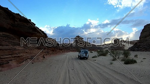 Follow shot for Safari car driving in Wadi Agarat, Sinai at day