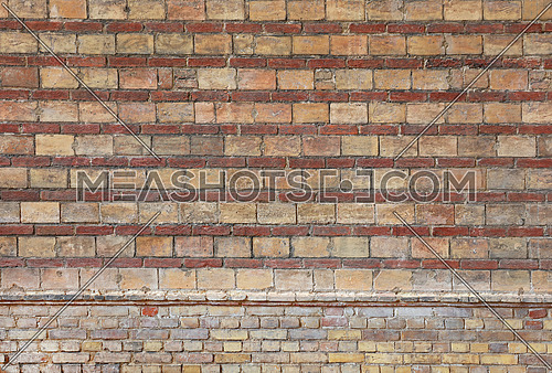 Rough red brown brick wall background texture with rows of red bricks, close up, side view