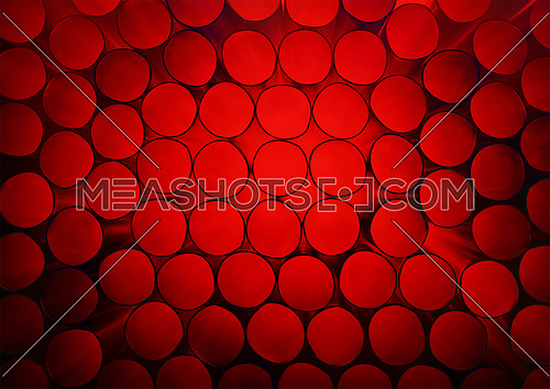 Abstract warm red toned vivid colorful background texture of backlit stack drinking straw circles