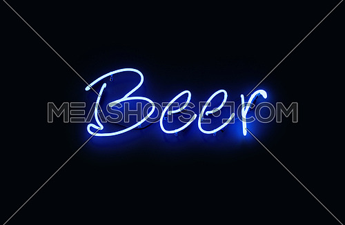 Close up BEER indigo blue neon light sign glowing in the dark over black wall background