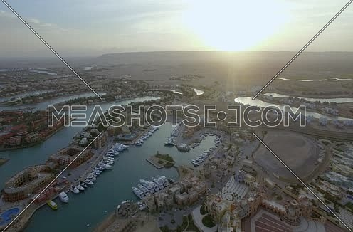 Drone shot flying above Al Gouna Marina  at sunrise