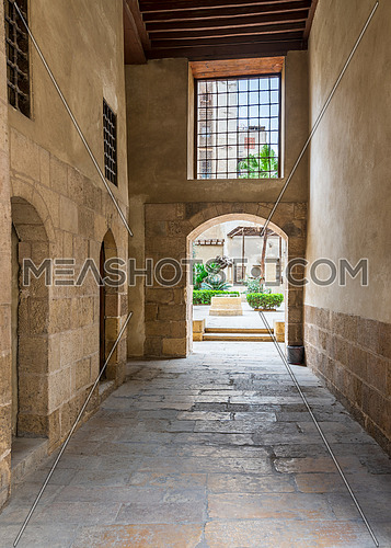 Stone bricks passage leading to the courtyard of historic Beit El Sehemy house located in Moez street, Gamalia district, Cairo, Egypt