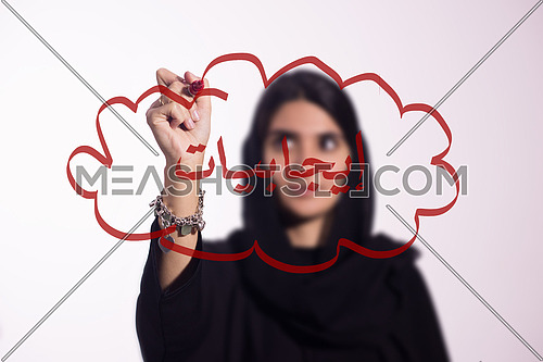 Arabian middle eastern business woman writing with a marker on virtual screen in arabic positiveness isolated on white background