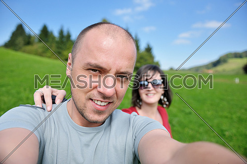 young happy couple have fun outdoor in nature