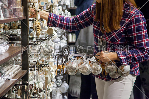 Woman selling Christmas decoration in a Belgium store in Brussels.