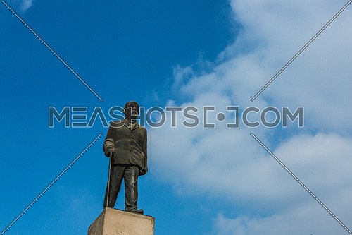 Low angel shot for Naguib Mahfouz Statue at Cairo at Day