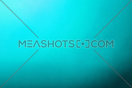 Abstract colorful background with grunge noise grain texture and vivid radial color gradient of teal blue from corner