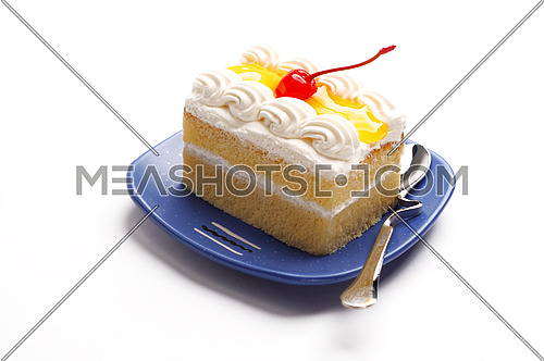 piece of lemon jelly cake with cherry on top ,on white background