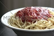 camera pan right on spaghetti plate with red sauce