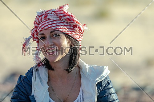 Close up for female tourist wearing bedouin traditions headscarf at Ain hodouda in Sinai by day