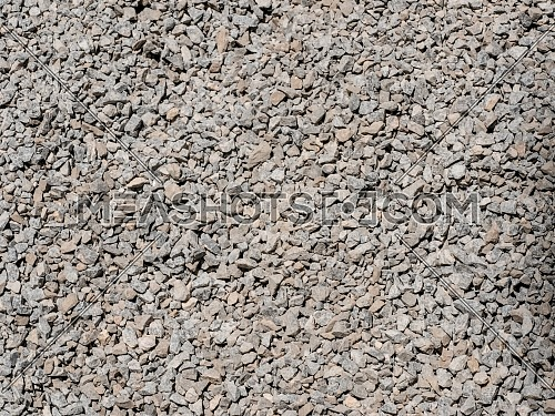 Abstract grey and beige gravel stone background crushed gray stones and granite pieces texture large detailed horizontal textured rough construction rock