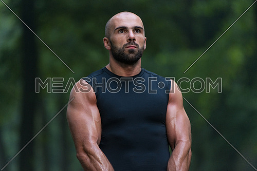 Young Fit Handsome Adult Man Posing Outdoors In Nature