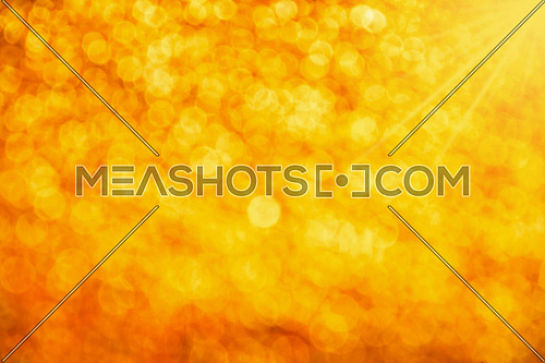 Golden glitter bright magic light circles summer sunshine abstract blur effect background