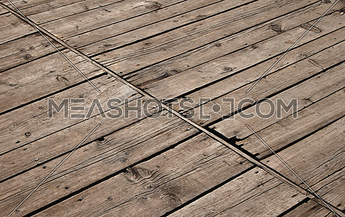 Old vintage rustic aged antique wooden sepia panel with diagonal gaps, planks and chinks