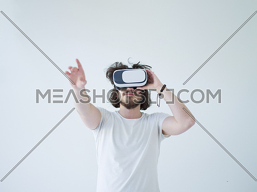 Happy man getting experience using VR headset glasses of virtual reality, isolated on white background