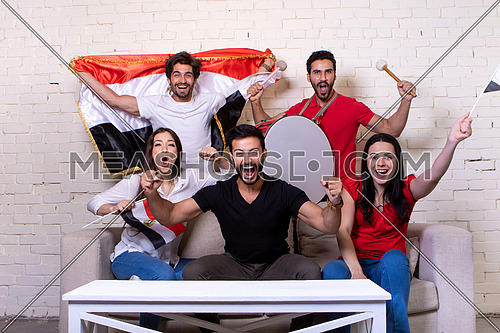 Group of people watching TV supporting the Egyptian Team