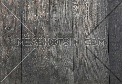 Old vintage aged grunge uneven vertical gray faded wooden vertical planks texture background with stains