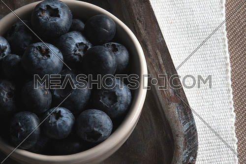 Blueberries in White bowl on a tray