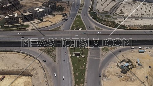 Aerial shot flying over Juhayna Bridge at 6th of October City during the corona pandemic lockdown by day 10 April 2020