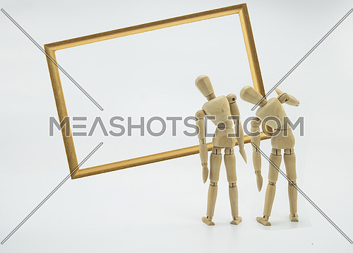 Wooden dolls look at a twisted picture, isolated on white background, conceptual image