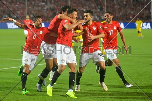 Cairo, Egypt - June 21: The Egyptian team celebrate a goal against Zimbabwe in the first group match of the 2019 African Cup of Nations between Egypt and Zimbabwe at the Cairo International Stadium on 21 June 2019 in Cairo, Egypt