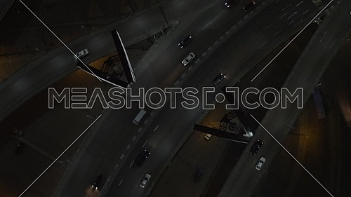 Ariel shot fly over Cairo City at Tahrir Area showing traffic, 6th of October Bridge at night - Novermber 2018