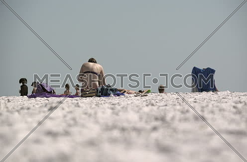 people sitting at the beach