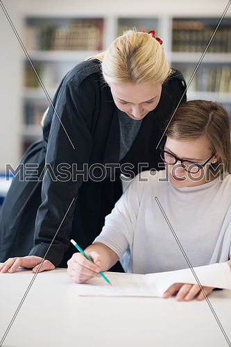 female teacher helping students on class about lessons and give support