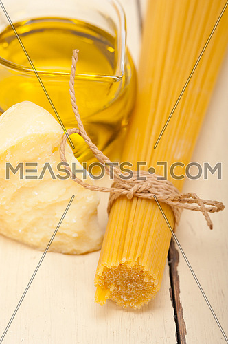 Italian pasta basic food ingredients parmesan cheese and extra virgin olive oil