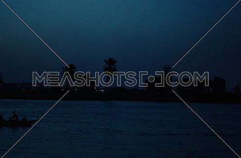 A boat sails in Rever Nile at night