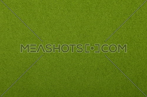 Yellow green colorful felt soft rough textile material background texture close up