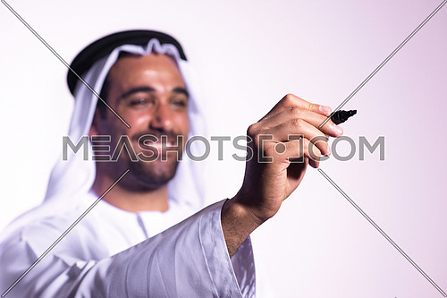 Arabian middle eastern business man writing with  marker on virtual screen isolated on white