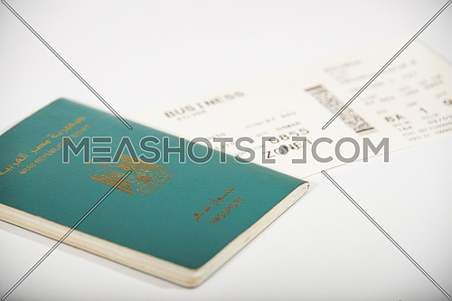 egyptian passport and boarding pass isolated on white