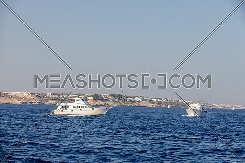 Long shot for yachts sailing showing Sharm El Shaikh City by day