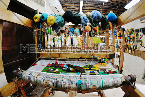 old wooden machine for produce traditional arabic rug