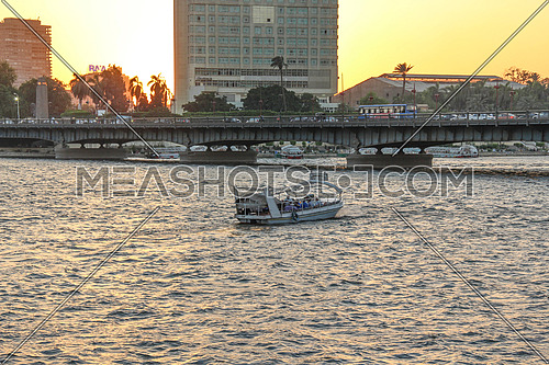 a photo from Cairo City , Egypt showing a felouka or boat crossing the River Nile