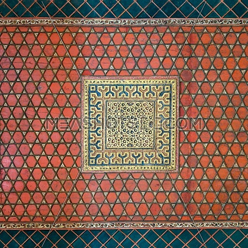 Part of wooden ceiling decorated with floral patterns painted in red and blue at Mamluk era Prince Taz Palace situated on the intersection of Saliba Street and Suyufiyya Street, Medieval Cairo, Egypt