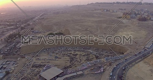 Reveal Shot for Wrecking yard from over Al Mukattam Mountain in cairo at sunset
