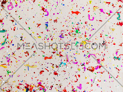 Confetti with wooden floor in the background