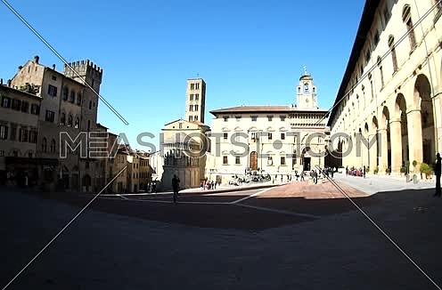 people walking on the Piazza Grande in Arezzo