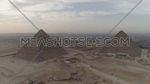 Reveal Shot for The Great Pyramids of Giza Area in Cairo by day.